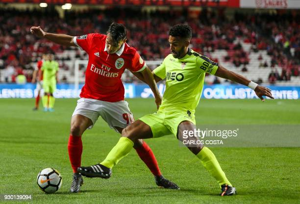 Benfica's midfielder Joao Carvalho vies with Aves' Argentinian midfielder Fernando Tissone during the Portuguese league football match between SL...