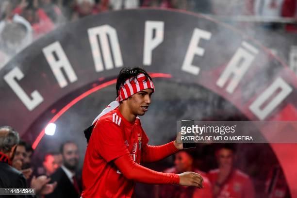 Benfica's midfielder Joao Felix arrives to celebrate as Benfica won the Portuguese League Championship at the end of the Portuguese League football...