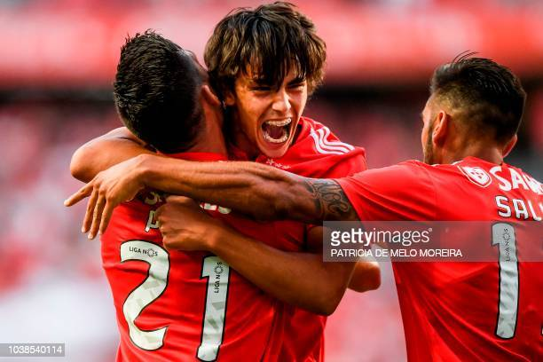 Benfica's midfielder Joao Felix celebrates a goal with teammates during the Portuguese league football match between SL Benfica and CD Aves at the...