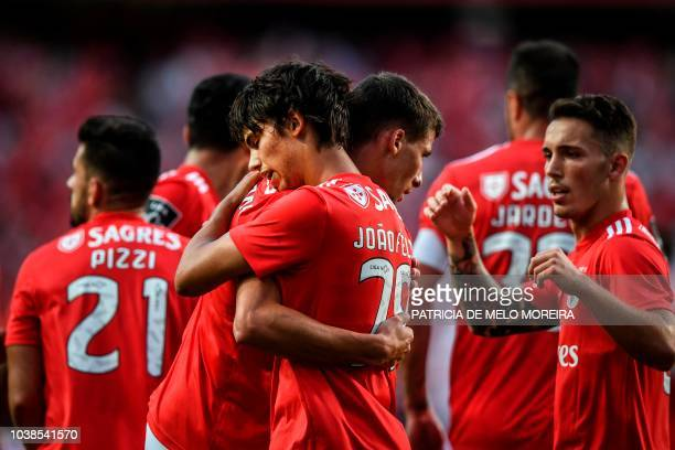 Benfica's midfielder Joao Felix celebrates with teammates after scoring a goal during the Portuguese league football match between SL Benfica and CD...