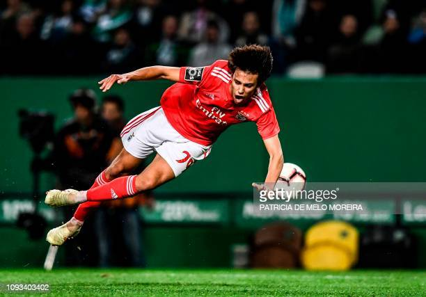 Benfica's midfielder Joao Felix jumps for the ball during the Portuguese League football match between Sporting CP and SL Benfica at the Jose...