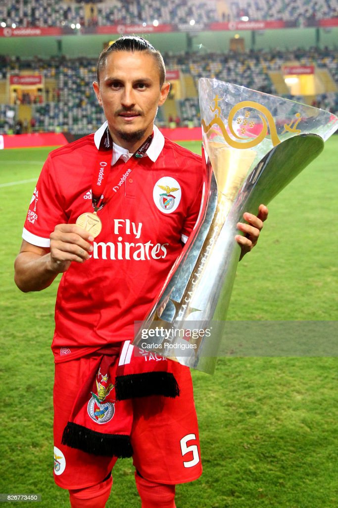Benfica's midfielder Ljubomir Fejsa from Serbia with Portuguese Super Cup trophy after the match between SL Benfica and VSC Guimaraes at Estadio Municipal de Aveiro on August 05, 2017 in Lisbon, Portugal.