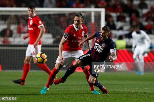 Benfica's midfielder Ljubomir Fejsa vies for the ball with Chaves's forward Pedro Tiba during Primeira Liga 2017/18 match between SL Benfica vs GD...