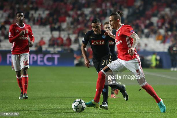 Benfica's midfielder Ljubomir Fejsa vies with Napoli's defender Faouzi Ghoulam during the UEFA Champions League Group B football match SL Benfica vs...