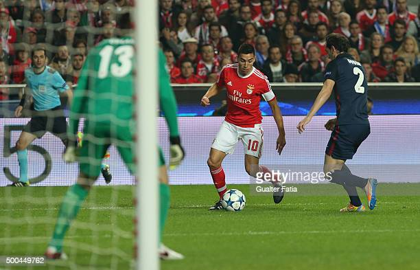 Benfica's midfielder Nico Gaitan with Club Atletico de Madrid's defender Diego Godin in action during the UEFA Champions League match between SL...