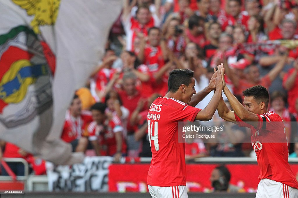 Benfica's midfielder Nicolas Gaitan and Benfica's defender Andre Almeida celebrates Benfica's goal during the Primeira Liga match between SL Benfica and Sporting CP at Estadio da Luz on August 31, 2014 in Lisbon, Portugal. (Photo by Carlos Rodrigues/Getty Images).