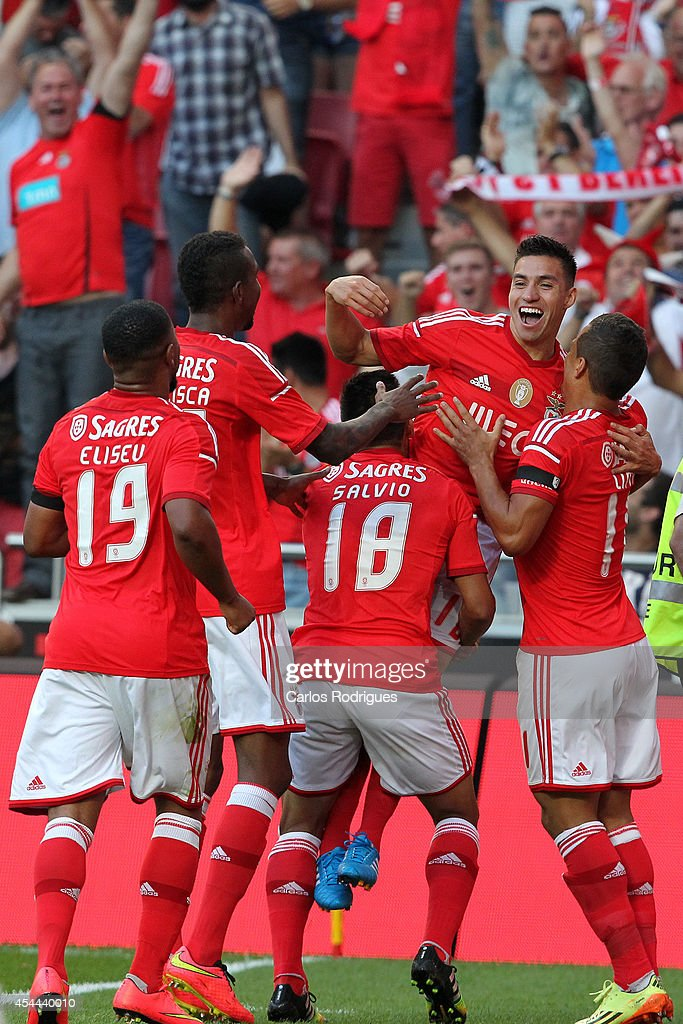 Benfica's midfielder Nicolas Gaitan and Benfica's forward Lima celebrates Benfica's goal during the Primeira Liga match between SL Benfica and Sporting CP at Estadio da Luz on August 31, 2014 in Lisbon, Portugal. (Photo by Carlos Rodrigues/Getty Images).