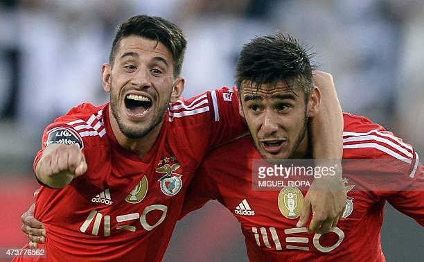Benfica's midfielder Pizzi and Argentinian forward Eduardo Salvio celebrate at the end of the Portuguese league football match Vitoria SC vs SL...