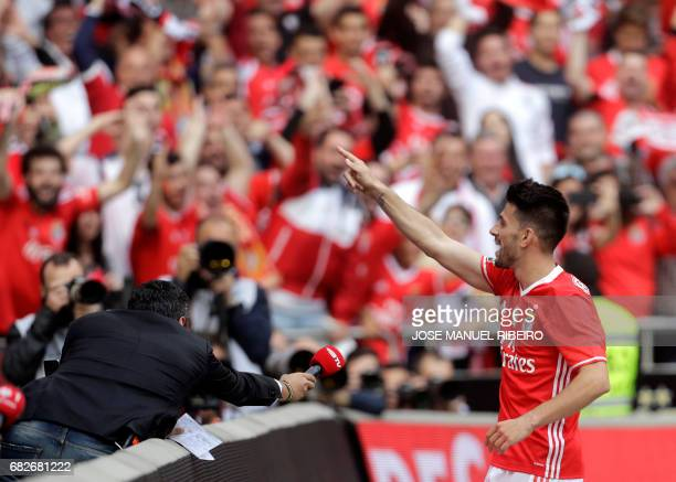 Benfica's midfielder Pizzi celebrates after scoring during the Portuguese league football match SL Benfica vs Vitoria Guimaraes SC at the Luz stadium...