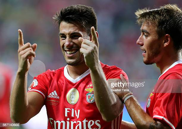 Benfica's midfielder Pizzi celebrates with teammate SL Benfica's midfielder Andre Horta after scoring a goal during the Super Cup match between SL...