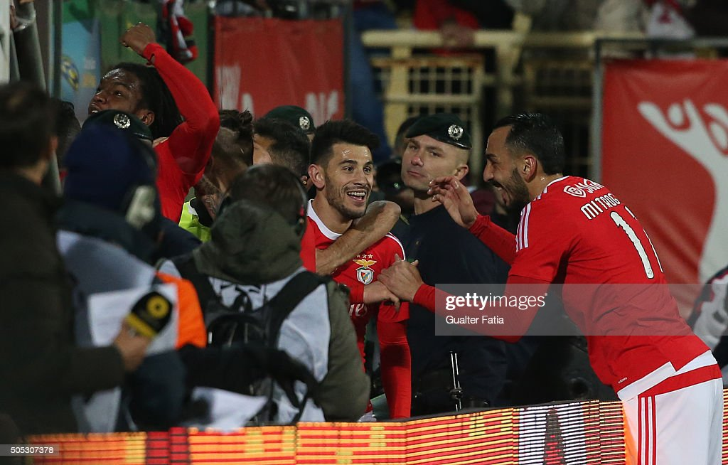 SL Benfica's midfielder Pizzi celebrates with teammate SL Benfica's greek forward Kostas Mitroglou after scoring a goal during the Primeira Liga match between GD Estoril Praia and SL Benfica at Estadio Antonio Coimbra da Mota on January 16, 2016 in Estoril, Portugal.