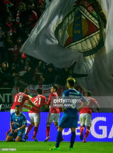 Benfica's midfielder Pizzi celebrates with teammates after scoring a goal during the Portuguese league football match CD Feirense vs SL Benfica at...