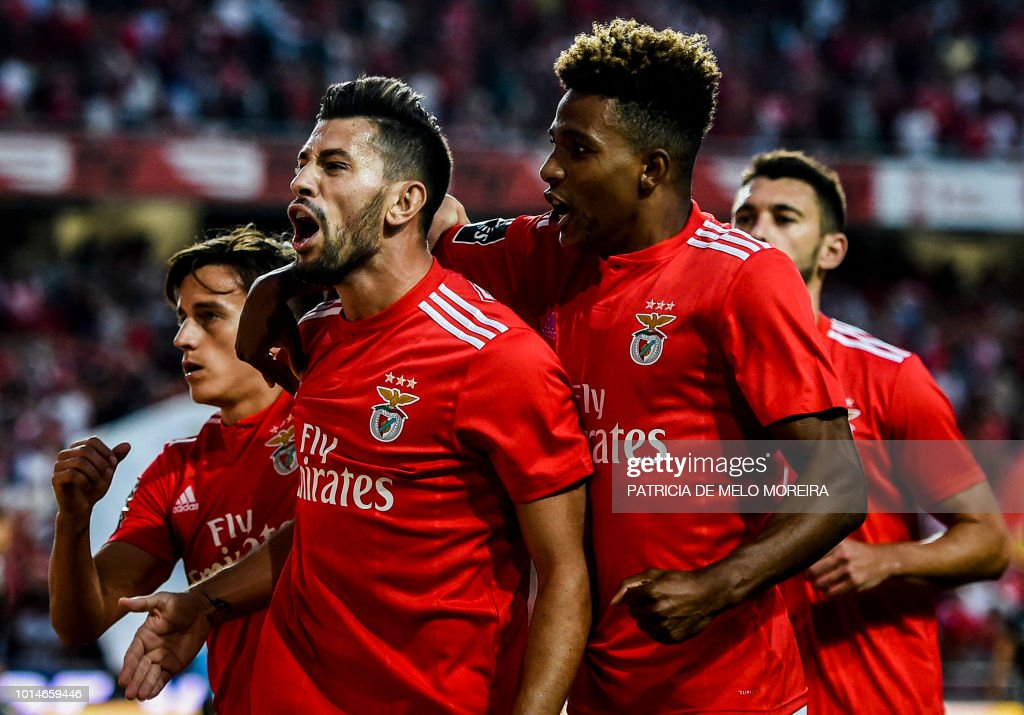 Benfica's midfielder Pizzi Fernandes (2L) celebrates a goal with teammates during the Portuguese league football match between SL Benfica and Vitoria Guimaraes SC at the Luz stadium in Lisbon on August 10, 2018.