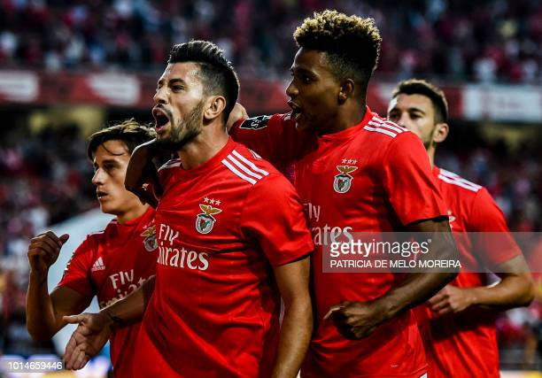 Benfica's midfielder Pizzi Fernandes celebrates a goal with teammates during the Portuguese league football match between SL Benfica and Vitoria...