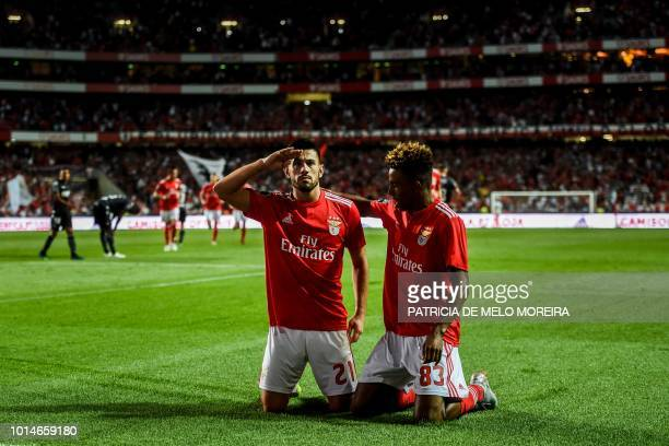 TOPSHOT Benfica's midfielder Pizzi Fernandes celebrates scoring a goal with teammate midfielder Gedson Fernandes during the Portuguese league...