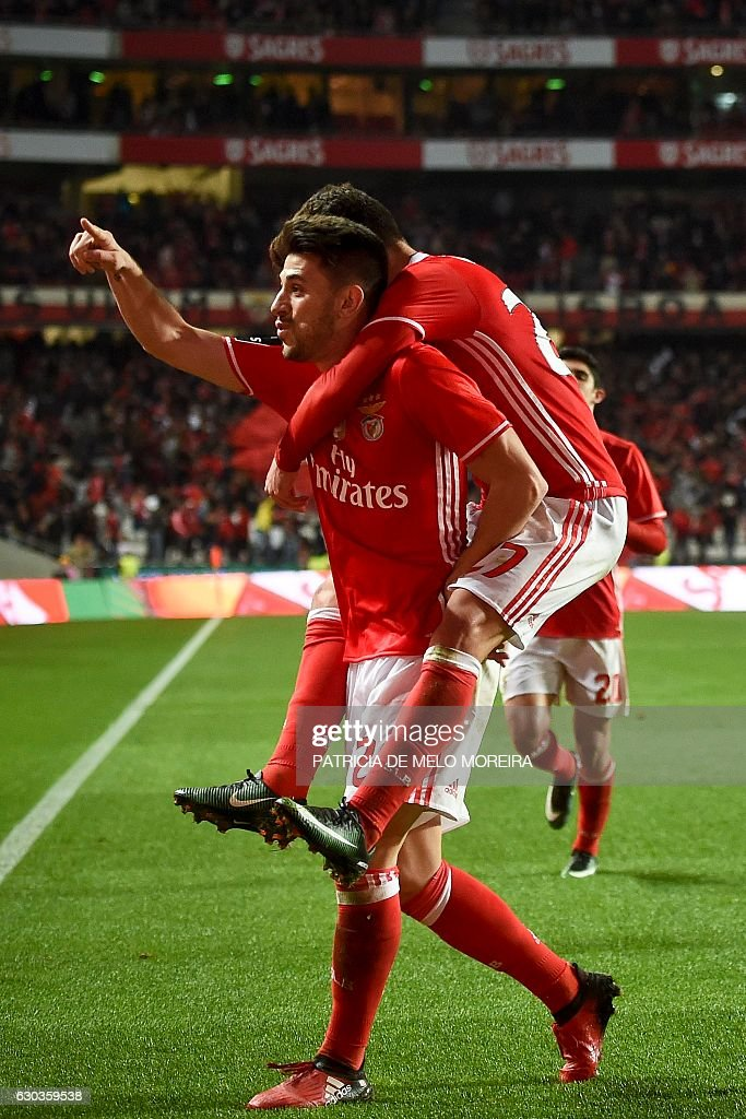 Benfica's midfielder Pizzi Fernandes (L) celebrates with his teammate Benfica's midfielder Rafa Silva after scoring during the Portuguese league football match SL Benfica vs Rio Ave FC at the Luz stadium in Lisbon on December 21, 2016. / AFP / PATRICIA