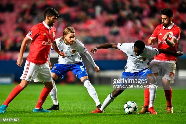 Benfica's midfielder Pizzi Fernandes challenges Basel's forward Dimitri Oberlin during the UEFA Champions League football match SL Benfica vs FC...