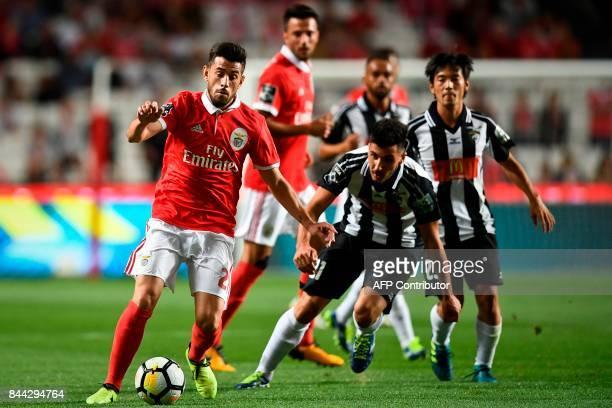 Benfica's midfielder Pizzi Fernandes vies with Portimonense's midfielder Pedro Sa during the Portuguese league football match SL Benfica vs...