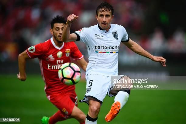 Benfica's midfielder Pizzi Fernandes vies with Vitoria Guimaraes' Brazilian Rafael Miranda during the Portugal's Cup final football match SL Benfica...