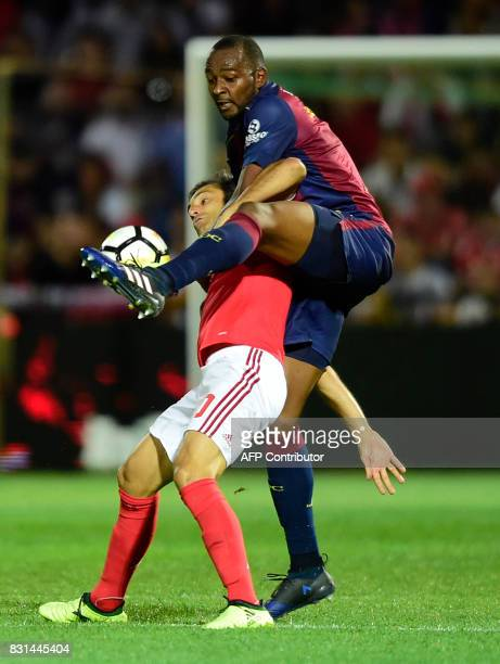 Benfica's midfielder Pizzi vies with Chaves' Brazilian defender Jefferson during the Portuguese league football match between GD Chaves and SL...