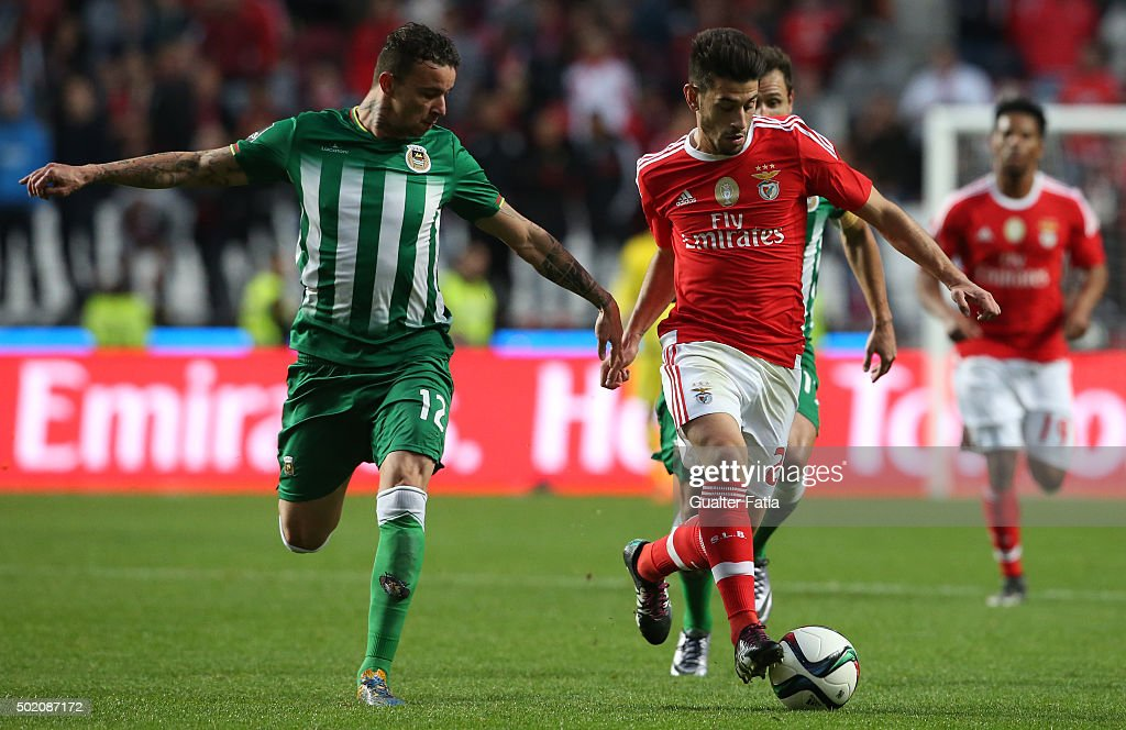 SL Benfica's midfielder Pizzi with Rio Ave FC's defender Lionn in action during the Primeira Liga match between SL Benfica and Rio Ave FC at Estadio da Luz on December 20, 2015 in Lisbon, Portugal.