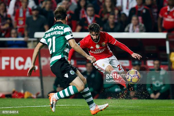Benfica's midfielder Rafa Silva vies for the ball with Sporting's defender Joao Pereira during Premier League 2016/17 match between SL Benfica vs...