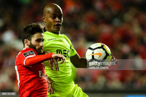 Benfica's midfielder Rafa Silva vies with Aves' Brazilian defender Jorge Felipe during the Portuguese league football match between SL Benfica and CD...