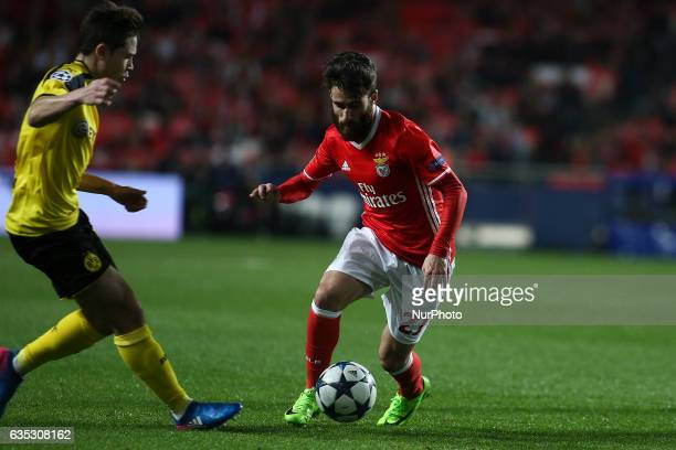 Benfica's midfielder Rafa Silva vies with Dortmund's defender Raphael Guerreiro during the Champions League football match between SL Benfica and...