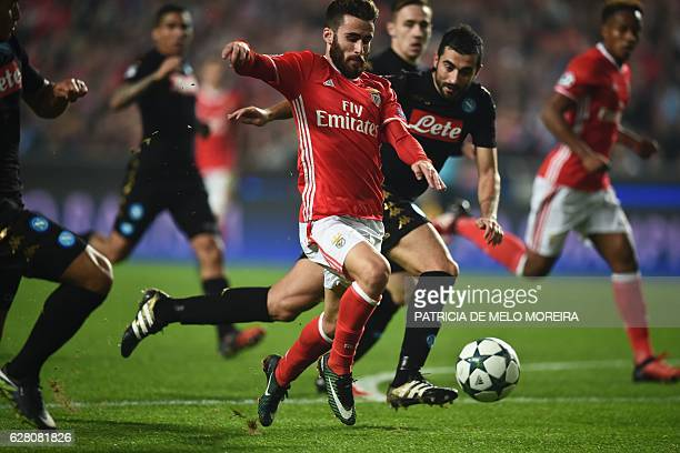Benfica's midfielder Rafa Silva vies with Napoli's Spanish defender Raul Albiol during the UEFA Champions League Group B football match SL Benfica vs...