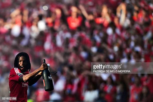 Benfica's midfielder Renato Sanches celebrates Benfica's 35th Portuguese league title at the end of the Portuguese league football match Benfica vs...
