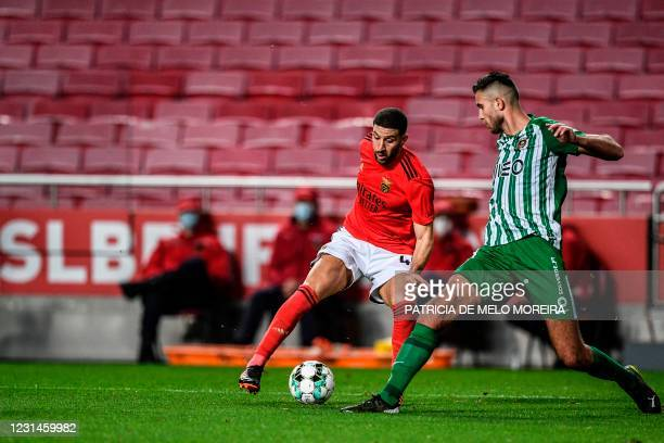 Benfica's Moroccan midfielder Adel Taarabt challenges Rio Ave's Croatian defender Toni Borevkovic during the Portuguese league football match between...