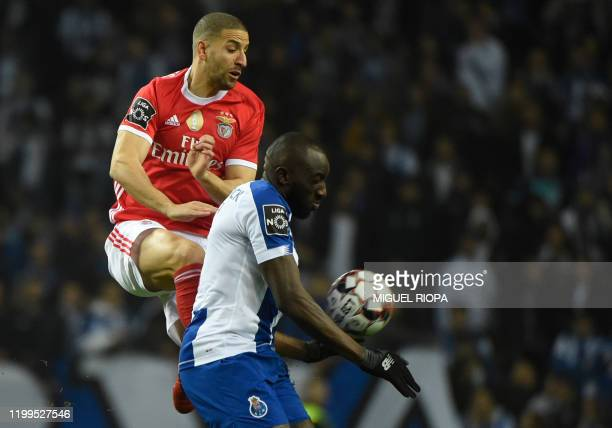 Benfica's Moroccan midfielder Adel Taarabt vies with FC Porto's Malian forward Moussa Marega during the Portuguese league football match between FC...