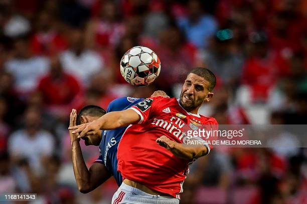 Benfica's Moroccan midfielder Adil Taarabt heads the ball during the Portuguese League football match between SL Benfica and Gil Vicente FC at the...