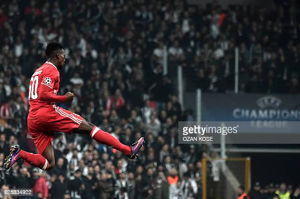 TOPSHOT Benfica`s Nelson Semedo celebrates with teammates after scoring a goal against Besiktas during the UEFA Champions League Group B football...