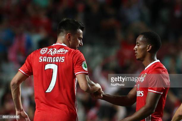 Benfica's Peruvian forward Andre Carrillo celebrates with Benfica's Greek midfielder Andreas Samaris scoring during the Portuguese Cup football match...