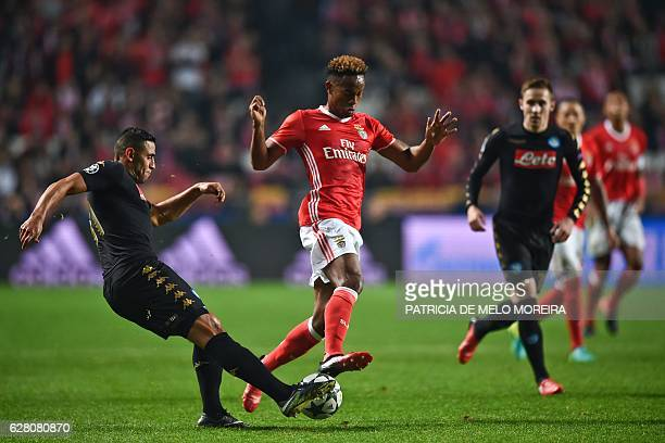 Benfica's Peruvian forward Andre Carrillo vies with Napoli's Algerian defender Faouzi Ghoulam during the UEFA Champions League Group B football match...