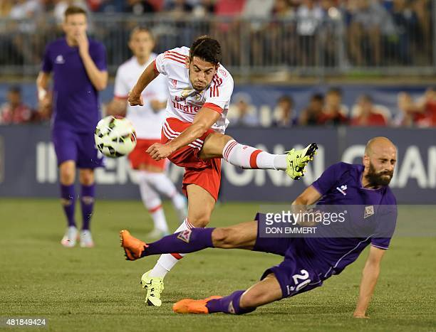 Benfica's Pizzi has a shot blocked by Fiorentina's Borja Valero during the International Champions Cup match between SL Benfica and Fiorentina July...