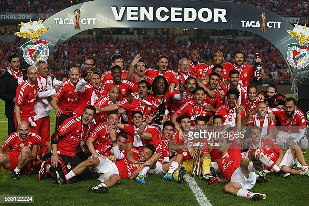 Benfica's players and staff members celebrate with trophy after winning the Portuguese League Cup Title at the end of the Taca CTT Final match...