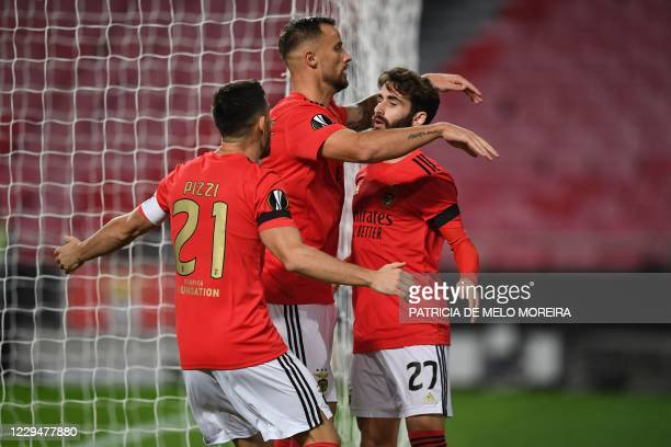 Benfica's players celebrate after an own goal by Rangers during the UEFA Europa League group D football match between SL Benfica and Glasgow Rangers...