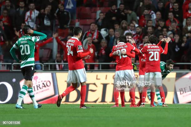 Benfica's players celebrate as Referee Artur Soares Dias signals a penalty for Benfica during the Portuguese League football match SL Benfica vs...