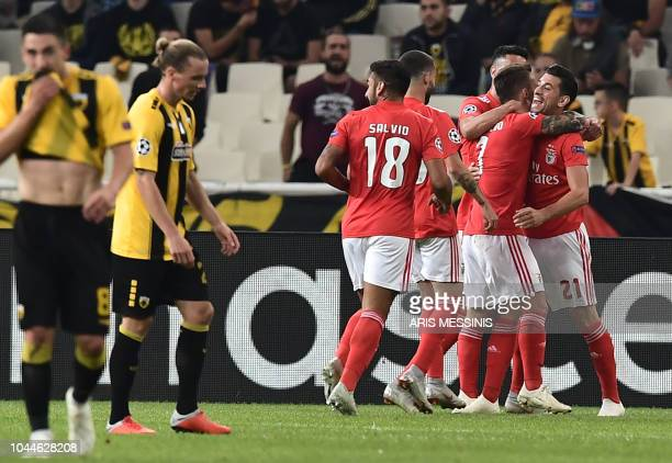 Benfica's players celebrate their goal during the UEFA Champions League football match AEK Athens vs Benfica Lisbon at the Olympic stadium in Athens...
