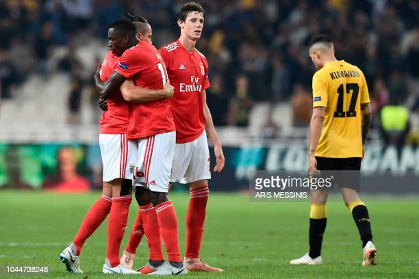 Benfica's players celebrate their victory at the end of their UEFA Champions League Group E football match AEK Athens FC vs SL Benfica at the OACA...