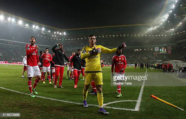 Benfica's players celebrate with supporters the victory at the end of the Primeira Liga match between Sporting CP and SL Benfica at Estadio Jose...