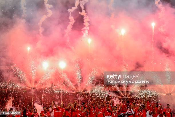 TOPSHOT Benfica's players celebrate with the trophy after Benfica won the Portuguese League Championship at the end of the Portuguese League football...