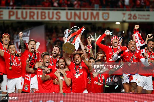 Benfica's players celebrate with the trophy after Benfica won the Portuguese League Championship at the end of the Portuguese League football match...