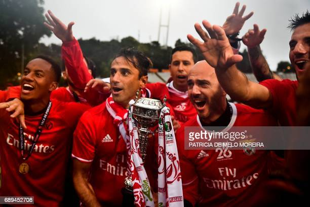 Benfica's players celebrate with the trophy at the end of the Portugal's Cup final football match SL Benfica vs Vitoria SC at Jamor stadium in Oeiras...