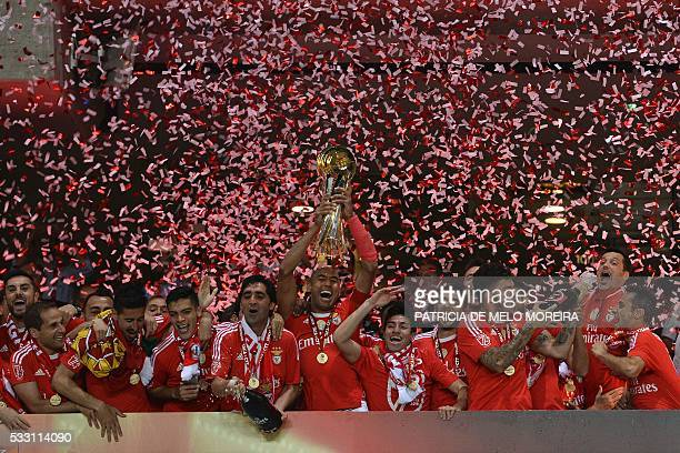 TOPSHOT Benfica's players celebrate with their trophy after winning the Portuguese League Cup final football match CS Maritimo vs SL Benfica at...