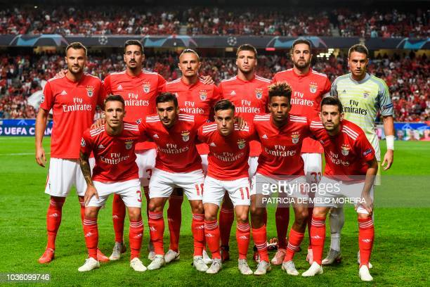 Benfica's players pose for a family photo Benfica's Swiss forward Haris Seferovic Benfica's Portuguese defender Andre Almeida Benfica's Serbian...