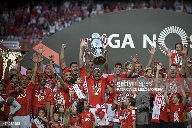 Benfica's players raise the trophy as they celebrate their 34rd Portuguese league title at the end of the Portuguese league football match Benfica vs...