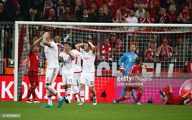 Benfica's players react after a missed chance on goal during the Champions League quarterfinal firstleg football match between Bayern Munich and...